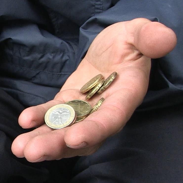 Bild Hand mit Münzen